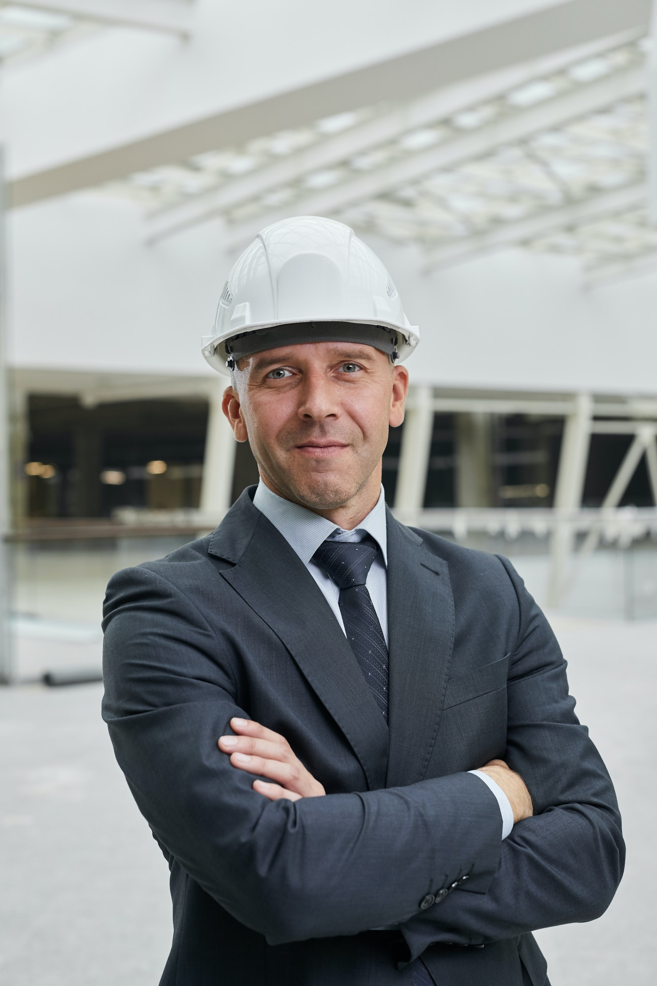 Confident Businessman at Construction Site